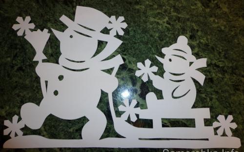 Сніговики на санчатах